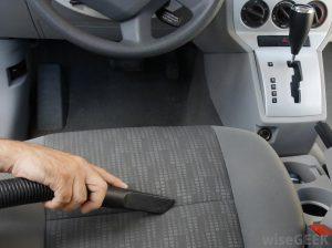 vacuum-being-used-on-car-seat